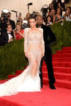 Best dressed stars at the MET gala 2015 - Kim Kardashian and her transparent/ sparkle/ feather dress