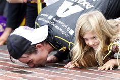 Jeff Gordon and daughter, Ella, kissing the bricks after his 2014 Brickyard 400 win!
