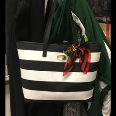 Working . . .will return all shares later Michael Kors Black White Tote Michael Kors Bags Totes