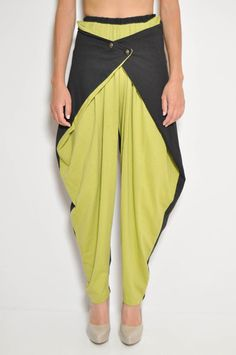 Harem / MC Hammer pants with weird front buttoning panels. I remember some girls wearing these in high school. An ugly trend taken to the next level...lol