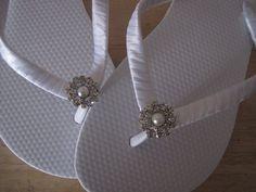 Wrap satin ribbon around flip flops and add embellishment.