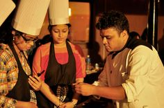 Chef engaging with ladies over an interactive cooking session