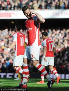 Olivier Girou celebrates scoring for Arsenal...