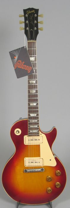Gibson 72/58 Reissue: Goof rings around embossed-logo P-90s, one piece bridge, speed knobs, classic 2-color sunburst, double-ring tuners