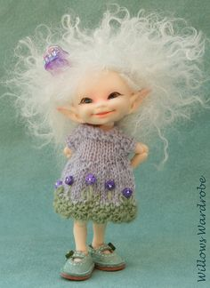 Realpuki doll, just adorable. Available intermittently from Fairyland, a Korean BJD company. Photo and clothes by Willow's Wardrobe on Etsy.
