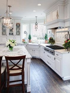 White cabinets seem to be a major draw in the Pinterst dream kitchen as well as granite slabs for the counter tops. Plus, who would mind doing dishes with a view like this?