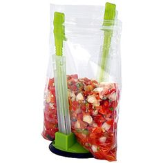 Two clamp-like arms allow this collapsible device to hold bags open so you can scoop in leftovers and still have an extra hand to use around the kitchen. Plus, you can hang a plastic baggie on each arm to dry. ($4; Amazon.com)