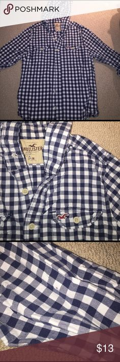Hollister button down hoody M Boys button-down navy and white checkered long sleeve hoodied shirt in size medium. Excellent condition but there is a number written on the inside tag and a dot on the left arm. See picture three. Hollister Shirts & Tops Button Down Shirts