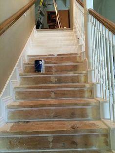 Home Remodeling Stairs Builder grade stairs, carpet removed and stairs painted. Removed old nasty carpet from stairs, stairs, reupholster - Because you deserve to love your home and the carpet you walk up and down! Wooden Staircases, Curved Staircase, Floating Staircase, Stair Railing, Railings, Stairways, Ladder Ideas, Installing Wainscoting, Faux Panels