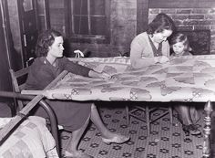 Quilting at the quilting frame--All of our Southern Grandmothers and a few of our Mothers  always made their own quilts.