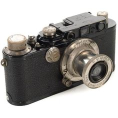 1930s Leica III Black Camera With 5cm Elmar Lens ($1,200) ❤ liked on Polyvore featuring home, home decor, filler, decorative objects, leica and black home decor