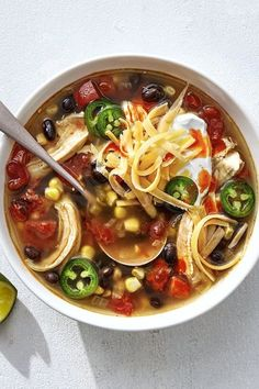 Slow-Cooker Chicken Taco Soup | Baby it's getting cold outside! Click here for our top slow-cooker soup recipes to make. #slowcookermeals #comfortfood #souprecipes | SL
