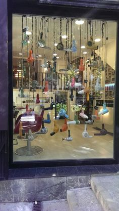 A really interesting window display for a hairdressers, looking at displays from a different approach