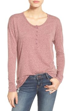Definitely needing this essential henley top for fall. Softly heathered jersey lends a comfy feel to this snap-front tee cut with a scooped neck and long, slim-fit sleeves.