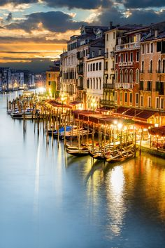 The famous grand canal from Rialto Bridge at blue hour in Venice, Italy