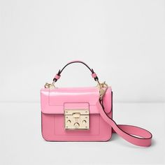 River Island Pink lock front mini satchel cross body bag (£22) ❤ liked on Polyvore featuring bags, handbags, pink, top handle satchel, mini handbags, mini crossbody purse, pink handbags and vegan handbags