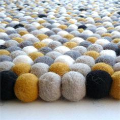 Create a playful and kid friendly room with the Sunshine Felt Ball Rug.  This adorable rug features a unique design that is perfect for nurseries, bedrooms and playrooms!