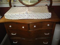 An organized dresser as a changing table