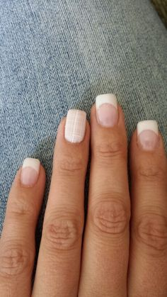 White french gel nails, pink accent nail with plaid.