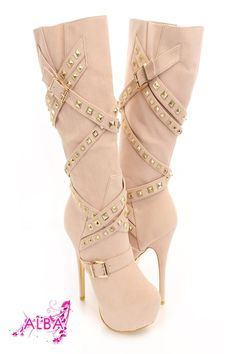 You will be head over heels for these saucy little numbers! They will perfectly compliment any outfit for any occasion! Make sure to add these to your collection, they definitely are a must have! The features for these boots include a faux suede upper with a wrap around strappy design with pyramid studded detailing, buckle accents, stitched detailing, almond shaped closed toe, gold bottom soles, full inner side zipper closure, smooth lining, and cushioned footbed. Approximately 6 inch…