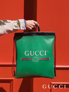 The retro-style Gucci vintage logo embellish drawstring backpacks featuring two leather handles to allow the style to also be worn as a tote, from Gucci Cruise 2018 by Alessandro Michele.