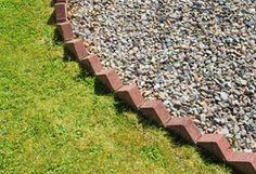 Bricks Set On Angle As Garden Border Toilin In The 400 x 300