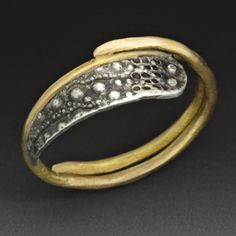 Peg Fetter: , Ring in 14k yellow gold and oxidized sterling silver.
