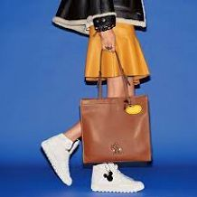 Winnipeg Canadian Stylist Fashion Consultant Chicwish flamingo midi skirt Pink Flamingo dangly legs bag