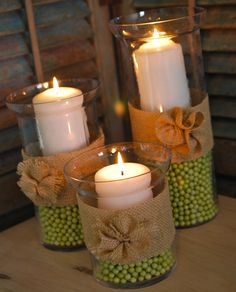 """hurricane vases with burlap and """"Itsy Beadsies"""" in Hobby Lobby's wedding aisle Diy Candles, Candle Centerpieces, Wedding Centerpieces, Centerpiece Ideas, Decoration Table, Decoration Noel, Wedding Decoration, Spring Decorations, Beautiful Decoration"""