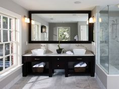 Using one big mirror instead of two smaller ones gives this bathroom a punch of subtle style. Users bookmarked this photo for the modern vessel sinks and the black wood vanity.  http://www.houzz.com/ideabooks/1045122/list/Readers--Choice--The-Top-20-Bathrooms-of-2011