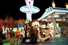 Cars Land transforms after dark, glowing with bright neon lights around its rides, shops and restaurants in Disney California Adventure Park at the Disneyland Resort