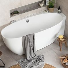 A revolutionary one piece luxury acrylic double ended bath. Almost freestanding, designed to be set in a corner and formed for comfortable bathing either . Big Bathtub, Bathtub Sizes, Clawfoot Bathtub, Corner Bathtub, Freestanding Bath With Shower, Small Bathroom, Family Bathroom, Bathroom Ideas, Spanish Bathroom
