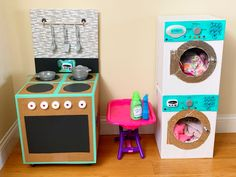 With just a few supplies that you likely already have around the house, you could make this DIY cardboard play kitchen for your little one in no time. Cardboard Kitchen, Cardboard Crafts Kids, Cardboard Box Houses, Diy Cardboard Furniture, Cardboard Playhouse, Cardboard Toys, Plywood Furniture, Diy Kids Kitchen, Cocina Diy
