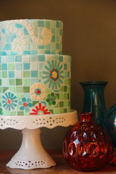 Mosaic celebration cake - hand cut blue and green mosaic tiles, with flower insets
