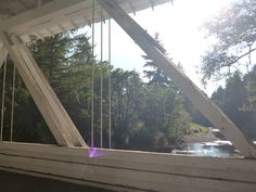 Looking through the open Howe Truss out on Thomas Creek.