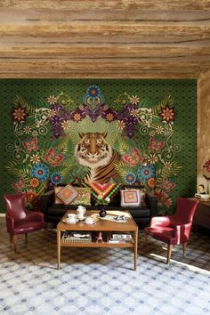 Why go for a single-color accent wall when you can have a giant colorful tiger mural presiding over your living room? Having this much color and pattern allows the rest of the room to be either spare or ariot with more color and pattern. This one straddles the two.