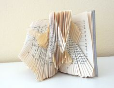 Love folding the pages of books to = art
