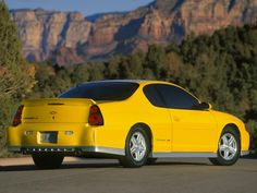 backside of a yellow turbocharged 2005 Monte Carlo SS