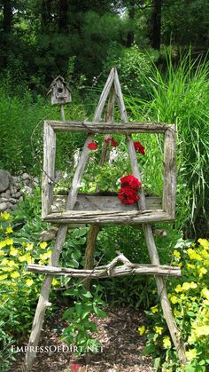 Outdoor Easel - made from salvaged wood or driftwood. Create garden art by filling a box with flowers, surrounding it with a frame made from found wood, thendisplaying it on a handmade easel - via Empress of Dirt