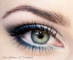Too much blue shadow can be overwhelming for your color, but this pretty shimmery, silver look is perfect for prom.