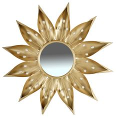 Highlighted by a flower-shaped frame, this metal wall mirror makes a striking statement.  Product: Wall mirror