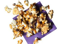 Peanut Butter-Banana (No. 40) : Make Peanut Butter Popcorn (No. 39), adding 1 cup dried banana chips and 1/2 cup chocolate chips with the peanuts.