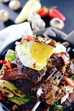 These chipotle bison burgers are an easy alternative to regular hamburgers and are topped with bacon, egg, peppers and mushrooms…