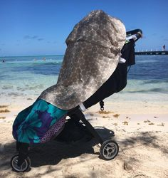 Everything youll need for baby's first summer holiday in the sun - pram cover