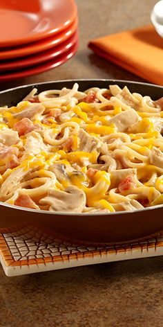 A leftover turkey recipe of spaghetti, turkey and mushrooms in a creamy sauce with zesty tomatoes for a flavor kick