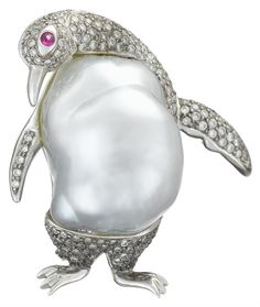 A cultured baroque pearl, diamond and eighteen karat white gold pendant brooch designed as a penguin with baroque silver pearl, accented by pavé-set round brilliant-cut diamonds and circular-cut ruby eye; total diamond weight approximately: 1.00 carat.