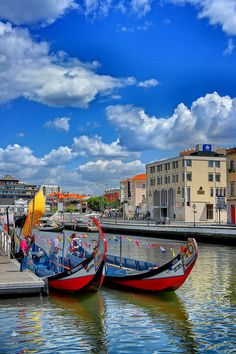 Aveiro. Portugal. Aveiro almost seems like part Venice and part Brighton Beach. Canals, bridges and painted boats called Moliceiros makes up part of the city, alongside the white sandy beaches of Costa Nova with their brightly painted houses. It's as though you are on two different continents at once!