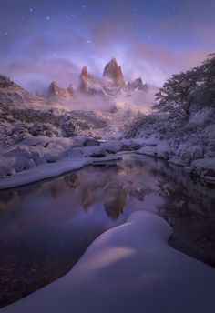 Moonlit Majesty - After a number of stronger, more dramatic images from Patagonia this winter, I figured I could share something more subtle.  ....well, as subtle as a peak like Fitz Roy gets anyway.  This image was made after a very heavy snowfall in the light of the moon, on an evening that took me from my nearby tent camp and down to this stream several times, looking at the light.  The stars blurred slightly for effect (I have it both ways).  Thanks for any thoughts, I appreciate them.