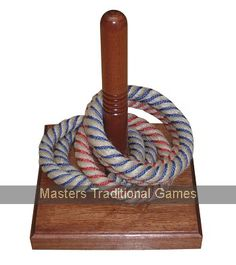 Deck Quoits. Rope Quoit game with wooden stake and base
