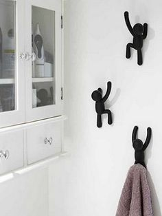 Add more character to your room with these black buddy hooks from Umbra. Designed to resemble people climbing up the walls, these hooks are perfect for small spaces and kids rooms. When they are not in use, these hooks still make for quirky wall decora Bathroom Accessories, Home Accessories, Decorative Wall Hooks, Black Kitchens, Coat Hooks, Bedroom Wall, Bathroom Hooks, Small Spaces, Home And Garden